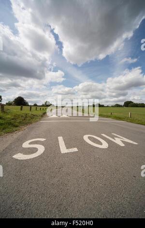 Slow, warning drivers of ramp ahead - Stock Photo