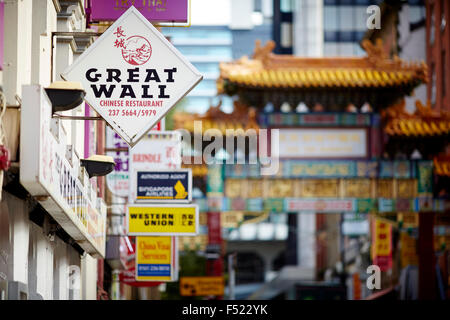 China town Manchester UK   Chinese arch Manchester village signs  Chinatown in Manchester, England is an ethnic - Stock Photo