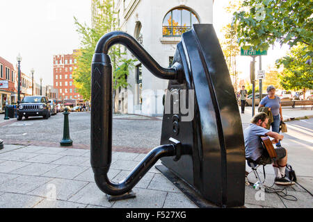 Flat Iron public art sculpture on the corner of Wall Street and Battery Park in Asheville, North Carolina. - Stock Photo