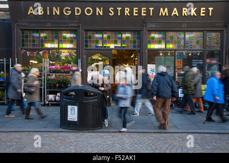 People passing the busy Abingdon Street Market entrance, Central Business District CBD, Blackpool, Lancashire, UK - Stock Photo