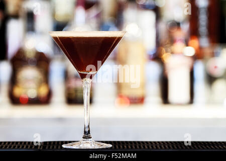 Espresso Martini Cocktail on a bar top - Stock Photo