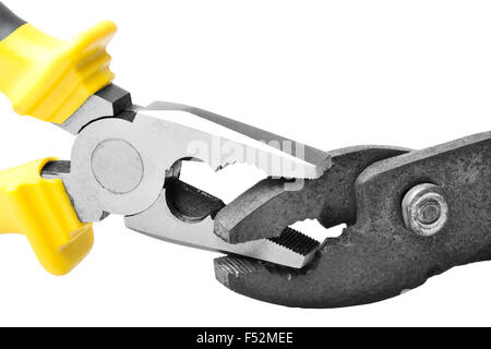 Pliers Biting On To Each Other Studio Isolated - Stock Photo