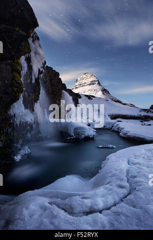 Iceland, Kirkjufell, night, moon, stars, ice, snow, winter, weird, light, mountain, icicle, water, waterfall - Stock Photo