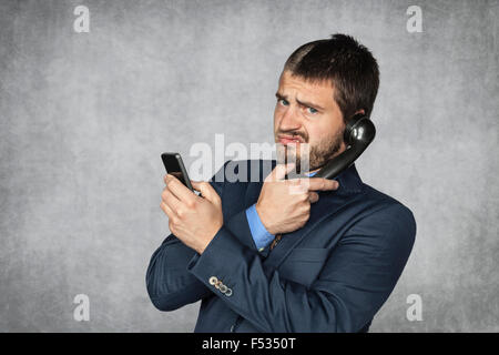 unhappy businessman talking on the phone - Stock Photo