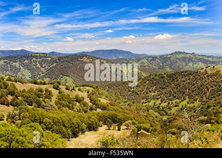 australian barrington tops mountains in national park on a sunny summer day viewed from remote lookout towards green - Stock Photo