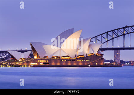 SYDNEY, AUSTRALIA, 10 JULY 2015 - Sydney opera house and Harbour bridge in Sydney at sunset. Iconic and world famous - Stock Photo