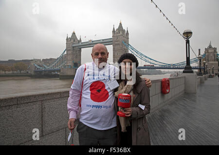 London, UK. 27th Oct, 2015. Poppy collectors stand by Tower Bridge in London. Credit:  Keith Larby/Alamy Live News - Stock Photo