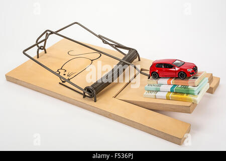 Mousetrap, bank notes, bundled, model car, symbolic image, car buying, vehicle expenses, acquisition, petrol costs, - Stock Photo