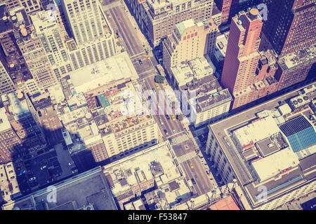 Vintage style aerial picture of Manhattan street with shadow of the Empire State Building, New York, USA. - Stock Photo