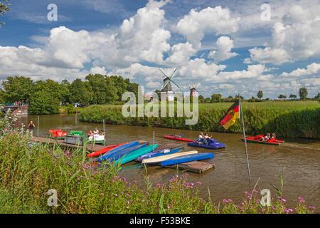 Landing stage, pedal boats, twin's mills in Greetsiel, Krummhörn - Stock Photo