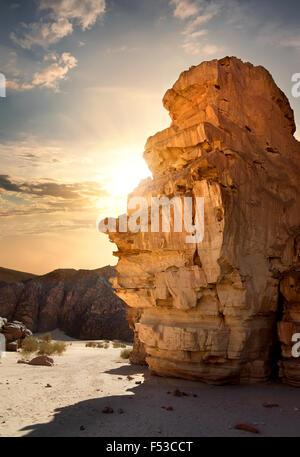 Rocks in canyon of Sinai at sunset - Stock Photo