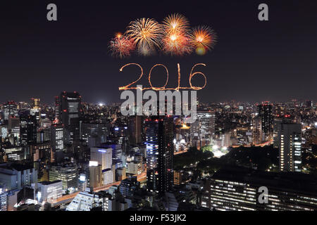 2016 New Year Fireworks celebrating over Tokyo cityscape at night, Japan - Stock Photo