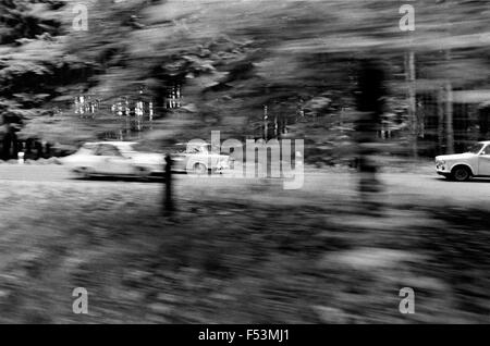 01.03.1990, Wernigerode, Magdeburg, German Democratic Republic - Passing cars photographed on a country road in - Stock Photo