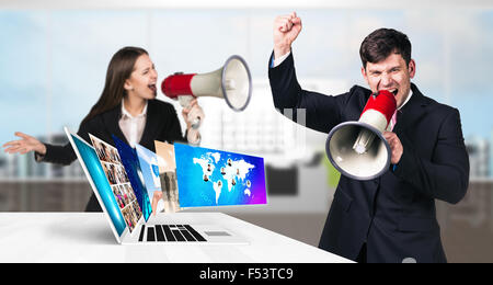 Businessman stands near laptop with many screens. - Stock Photo