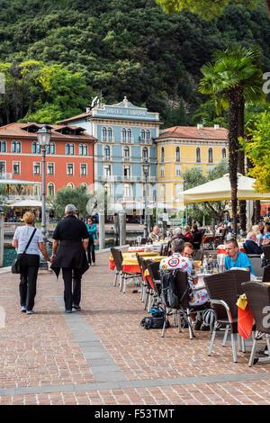 Outdoor cafe in Riva del Garda, Lake Garda, Trentino, Italy - Stock Photo