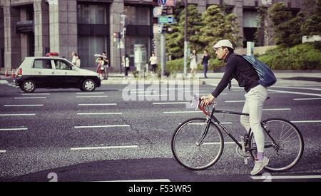 Cyclist waiting at the traffic light - Stock Photo
