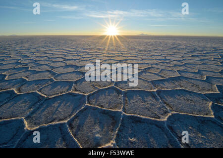 Honeycomb-structure with shadows on a salt lake at sunrise, world's largest deposits of lithium, Salar de Uyuni, - Stock Photo