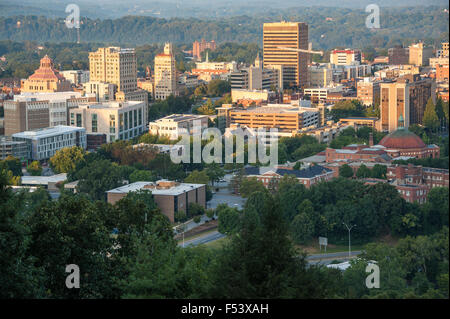 Sunrise lights the city of Asheville, North Carolina, nestled in the Blue Ridge Mountains. USA. - Stock Photo