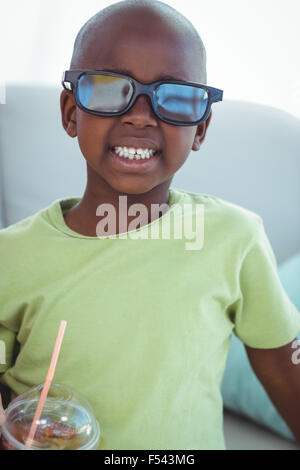 Smiling boy wearing 3d glasses for a movie - Stock Photo