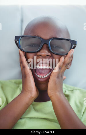 Close up of a boy wearing 3d glasses for a moive - Stock Photo