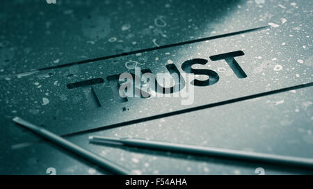 Word trust engraved in black stone with tools and blur effect. Concept image for illustration of strong relationship - Stock Photo