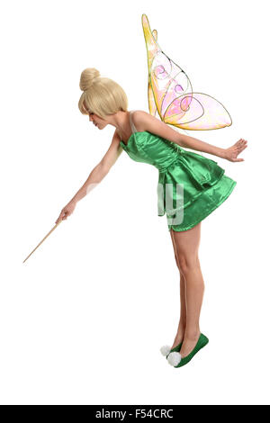 Young woman dressed in mythological being using magic wand - Stock Photo
