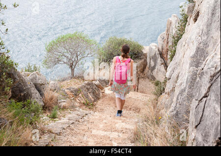 Person walking on a coastal path (sentier littoral) from Nice towards Villefrance sur Mer, Côte d'Azur, France