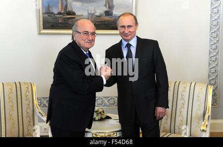Russian President Vladimir Putin meets with President of the International Federation of Football Associations Sepp - Stock Photo
