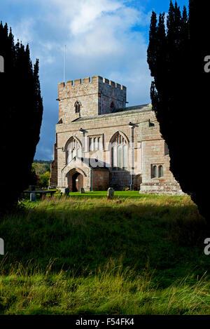 St Andrew's Church, framed by yew trees, Greystoke, Cumbria, England UK - Stock Photo