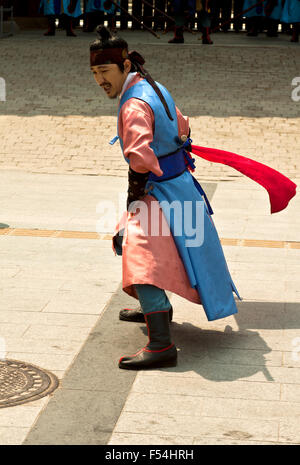 Seoul, Korea - May 14, 2015:  Armed guards in traditional costume guard the entry gate at Deoksugung Palace, a tourist - Stock Photo