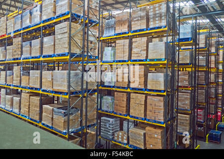 Lines of stacked pallets in warehouse UK - Stock Photo
