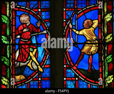 Stained glass window depicting a Saint killed by an arrow in the Cathedral of Tours, France. - Stock Photo