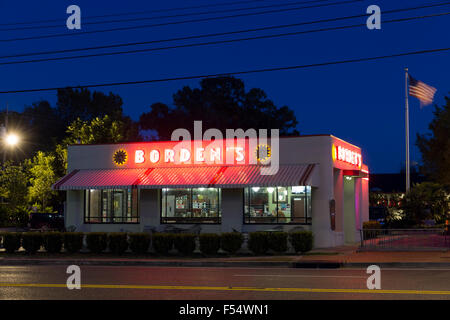 Borden's typical ice cream parlor with Stars and Stripes flag at night in Layfayette,  Louisiana, USA - Stock Photo