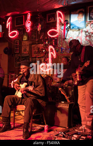Blues band, guitarist, drums, vocals in live performance on stage at Red's Lounge Blues Club in Clarksdale, Mississippi, - Stock Photo