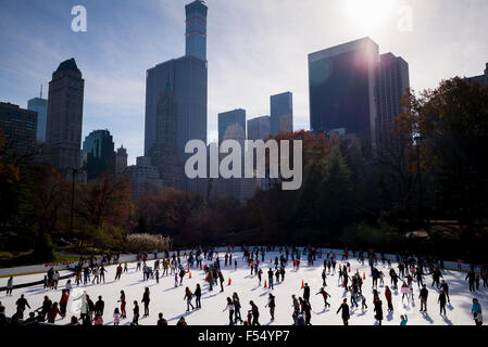 Winter scene of New Yorkers, keen skaters, ice skating at the Wollman Memorial Rink in Central Park, New York, USA - Stock Photo
