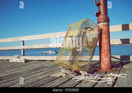 Lobster traps with yellow fishing boat and red house in fog at Stock Photo: 25405620 - Alamy