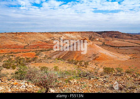 Australian outback landscape from hilltop lookout, conical peak rising from valley hemmed with rocky barren hills, - Stock Photo