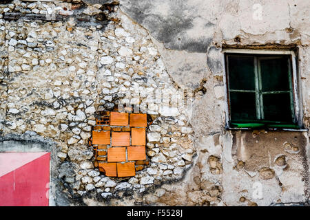 Repaired damage from Bosnian Civil War in a house in Mostar. - Stock Photo