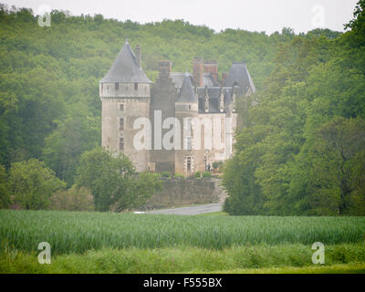 Entering a Mist Shrouded Château. A man enters Chateau de Montpoupon in the misty Loire countryside following a - Stock Photo