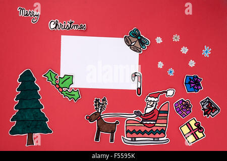 a horizontal overhead view of a scrapbook xmas greeting with a Happy ...