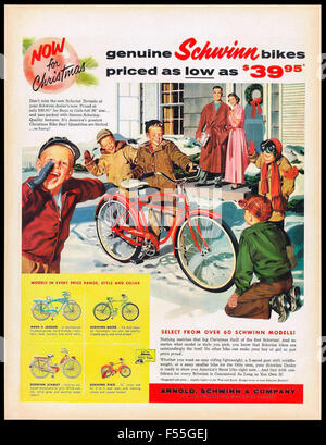 Schwinn Bicycles Christmas advertisement 1957 featuring boy with new Schwinn Tornado bicycle with friends looking - Stock Photo