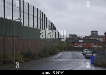 Belfast,Northern Ireland: The republican area of Bombay street is separated by a barrier called 'Peace line' from - Stock Photo