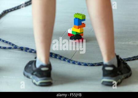 Lego bricks, Plastic cubes in the hands of a child's game that develops creativity and imagination - Stock Photo