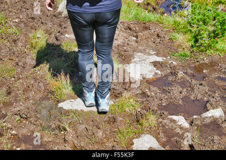 Female hiker in Zillertal alps, Tirol, Austria. Close up of the legs and boots Model release available - Stock Photo