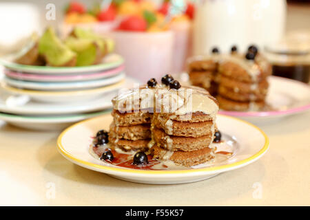Whole wheat pancakes with fruit. This image has a restriction for licensing in Israel - Stock Photo