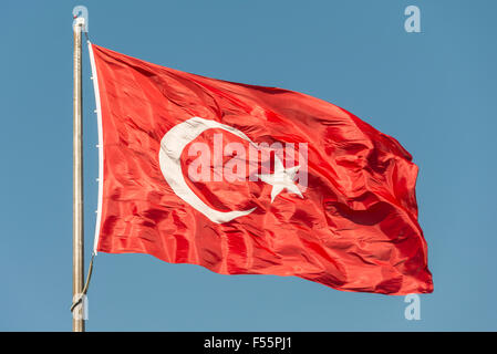 Turkish flag waving in the wind - Stock Photo