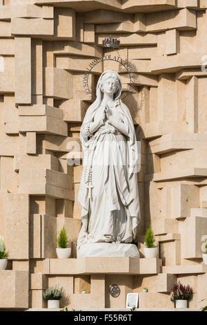 Statue of Our Lady of Lourdes, 1908, Santuario Nostra Signora di Lourdes monastery, Verona, Veneto, Italy - Stock Photo