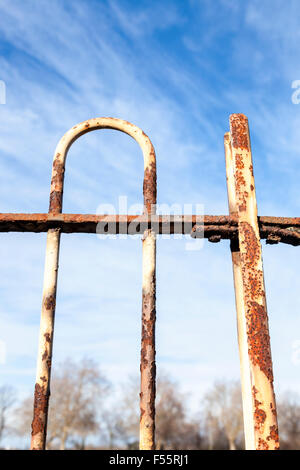 Old rusting metal railing with flaking white paint, England, UK - Stock Photo