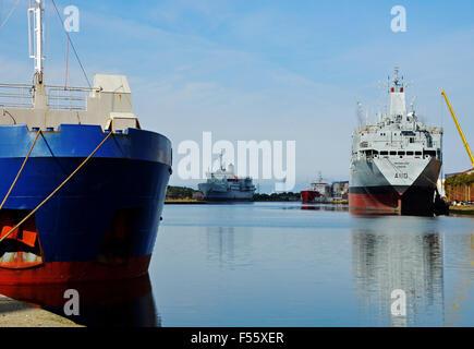 Four ships set around a dock in Birkenhead, Wirral, UK including RFA Fort Austin, RFA Orangeleaf, MV Richelieu and - Stock Photo