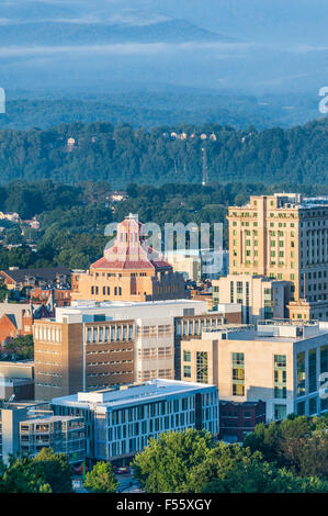 Downtown Asheville, North Carolina nestled in the Blue Ridge Mountains and illuminated by the rising sun. USA. - Stock Photo